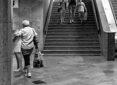 #Legs... I spotted this lady carrying her legs on the #Prague #metro. I liked the balance with the family on the #steps. Photography Workshops, Creative Photography, Uk Europe, Creative Costumes, Holiday Travel, Prague, The Good Place, Legs, Creative Costuming Designs