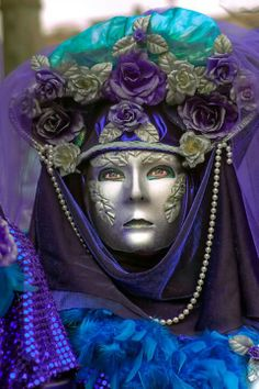 purple and blue with silver mask