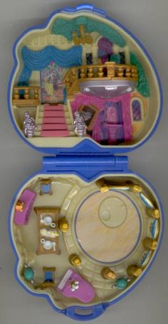 Beauty and the Beast polly pocket set, 1995.  I liked the figures that came with the Disney ones.  I never realized there were so many different Disney sets, though.