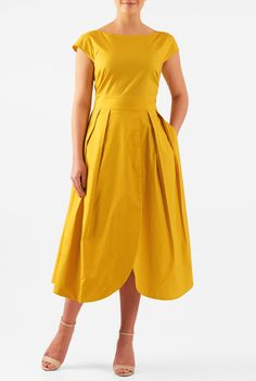 Our stretch cotton poplin dress is cinched in at the banded waist with a pleated wrap skirt and rounded hems for an interesting tulip style.
