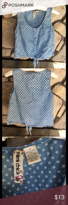 Blue & White Polka Dot Sleeveless top Faux denim like faded blue sleeveless top with white polka dots. Tie Waist, pearl buttons, 1 chest pocket. Great condition, no rips, stains, smoke free home. Mimi Chica Tops Tank Tops