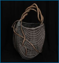 Slate basket by master basket weaver Tina Puckett. The use of the natural materials and the shape reminds me of oriole nests