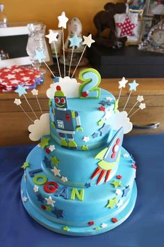 Shiny Rubbie People - 3 tier blue green red rockets robots stars naming day baby cake