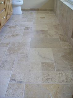 Travertine Natural Stone Tile in the Versaille Pattern on the Floor.