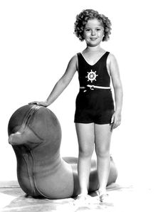 Shirley Temple and a weird 30′s pool inflatable, 1936.