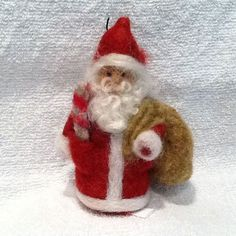 Needle felted christmas - Needle Felting Santas from Around the World by Barbara Traficonte – Needle felted christmas Wool Needle Felting, Needle Felting Tutorials, Needle Felted Animals, Wet Felting, Felt Animals, Felt Christmas Decorations, Felt Christmas Ornaments, Christmas Crafts, Diy Ornaments