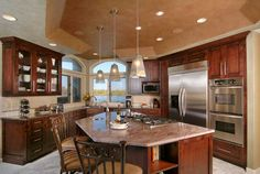 Beautiful colors - dark cabinets with lighter back splash offers a nice contrast