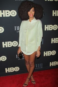 The singer's shirtdress at The Beyonce: Life Is But A Dream New York Premiere in New York City. Solange refines your borrowed-from-the-boyfriend shirt style in a more luxe fabric and sleek accessories.