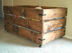 You can build this easy toy box on casters. Simply AWESOME! Free Plans at Ana-White.com. Built by ahouse-2-home toy box rolling wood diy make build easy wood pine simple rustic industrial