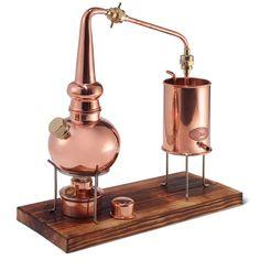 The Classic German Copper Distiller - Hammacher Schlemmer. Make your own essential oils! Hammacher Schlemmer, Whisky, Whiskey Still, Copper Still, Pure Copper, Essential Oil Distiller, Medieval Recipes, Moonshine Still, Buy Essential Oils