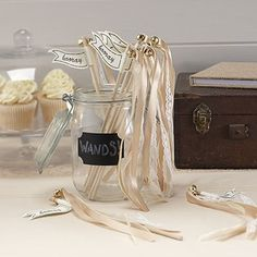 "As an alternative to confetti these wedding wands are just beautiful. They have gorgeous gold satin ribbon and ivory lace ribbon adorned with a pretty gold bell. The sign reads "" hooray"". Used at the ceremony or at the venue your guests will love these wands."