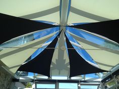 Black and white shade sail blinds conservatory