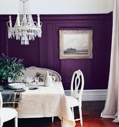 Purple dining room.  Would be very pretty with only the one wall dark purple and the rest a kind a pale silvery grey or palest shade in the dark's family.