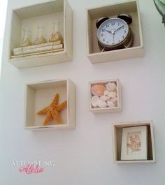 Shadow boxes are a cute way to add flare to an Ocean themed bathroom! <3   Don't you think so too? :o)