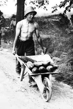 Young British soldier transporting shells, Messines, Belgium, 1917. - Found via Buzzfeed