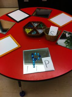 Loose parts letters discovery bin.