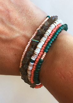 Make it feel like summer every single day when you have this beauty around your wrist! Four strands made of shell, sea glass and laboradite. All 4 strands come together and connect with one clasp. Thi