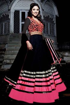Black Soft Net Anarkali churidar suit. Resham embroidered yoke with crystal work. Embroidered band collar V neck ,Long length, full sleeves kameez/ top. Shantoon churidar & net dupatta.Product are available in 34,36,38,40,42, 44, 46, 48 sizes. It