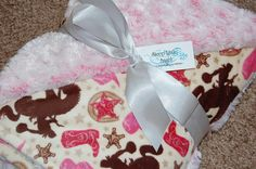 I just ordered the cowgirl fabric to make one for Addys bed :) this is her room theme!
