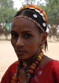 Fulani woman wearing traditional Amber beads and silver coins