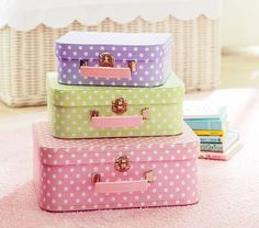 I love the Nesting Dot Suitcases on potterybarnkids.com  One of us could decopage some old suitcases and make them in any pattern we want - fun!!