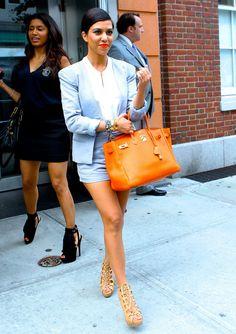 Blue matching blazer  shorties, white blouse, orange Hermes bag and orange lips
