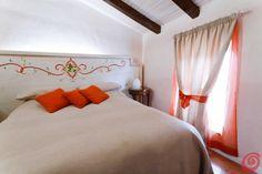 Camere da letto :: Camera da letto rustica arancio