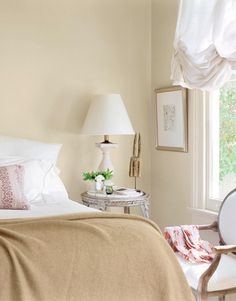 Big Easy Style: Crisp, white linens and a cashmere throw make for sweet dreams in the master bedroom. The marble-top taboret table dates from Bold colors are limited to accessories here—like the red throw pillow resting atop the comforter. Home Bedroom, Bedroom Decor, Master Bedroom, Bedroom Stuff, Bedroom Ideas, My Home Design, House Design, Nautical Bedroom, New Orleans Homes