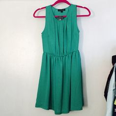 Turquoise dress Turquoise sleeveless dress. Length is above the knee Dresses