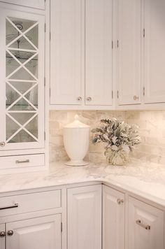 Backsplash tiles are 3″ x 6″ Calacutta Gold marble and the countertop is Calacutta Gold as well.