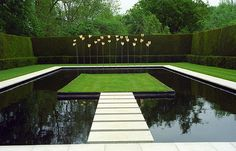 This is a contemporary water feature within the gardens of Kiftsgate Court near Chipping Camden in the Cotswold. The kinetic sculpture, behind the pool, sways gently in the breeze whilst water trickles on to the pool below. Anne Chambers, the current custodian of Kiftsgate, was responsible for creating this water feature out of what was the old tennis court. www.kiftsgate.co.uk