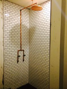 Hall bath shower in progress, exposed copper pipe, subway tile, penny tile