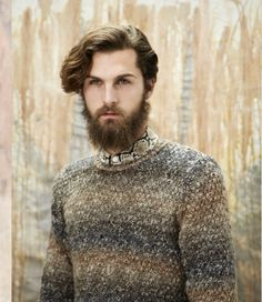Hauntingly handsome Fabian Nordstrom, a man with a prophetic gaze, Viking beard and pale skin.