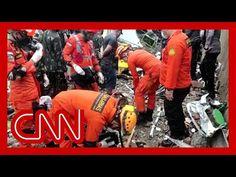 'Desperate' rescue efforts ongoing as Indonesia quake kills dozens - YouTube