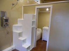 I like these stairs! thow This is an x Toy Hauler tiny house for sale! From the outside, you'll notice green siding, a flat metal roof, and an orange-red door. When you go inside, you'll find … Tiny House Stairs, House Staircase, Tiny House Loft, Tiny House Storage, Small Tiny House, Tiny House Living, Tiny House Plans, Tiny House On Wheels, Tiny House Design
