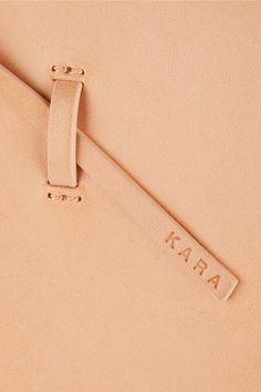 Sand leather (Cow) Tie fastening at open top Designer color: Nude Weighs approximately 2.6lbs/ 1.2kg