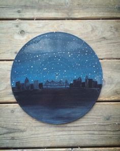 Painting on old vinyl record. Follow on Instagram @dollarbindimes #records #vinyl #skyline #acrylic #painting #diy #art