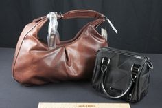 NEW WITH TAGS LIZ CLAIBORNE BROWN HOBO STYLE SHOULDER BAG AND SMALL NINE AND COMPANY HAND BAG WITH PATENT HANDLES.