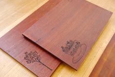 Beautiful illustrations laser engraved onto smooth wood. Lovely!
