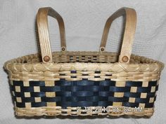 This beautiful handwoven sturdy basket will hold a 9X11 cake or casserole dish. This basket is woven with natural and navy dyed reed on