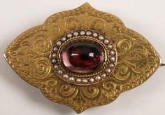 Victorian gold lozenge shape brooch with central foil back crystal and pearl cluster, photo locket reverse.