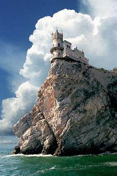 Swallows Nest Sea Castle, Crimea. #crimea #swallows_nest #sea #castle #cliff #ocean #clouds #photography #green