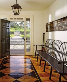 Rustic Entrance Hall by Karin Blake and Nantucket Architecture Group in Nantucket, Massachusetts