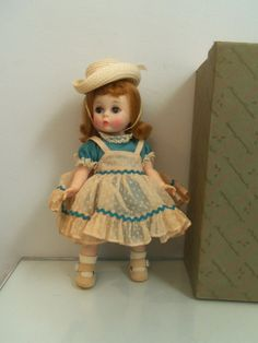 Wearing a polished blue cotton dress with matching panties a dotted nylon pink pinafore, straw hat, white socks, beige shoes found in a Mde Alexander box for Littlest- Kitten. box will be included. | eBay!