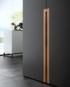Beautiful matte black cupboard with a timber detailed handle.