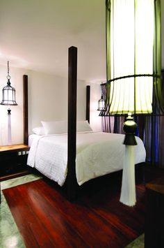 Peace and privacy are the central pivots of this luxury boutique hotel, which is surrounded by a high wall as well as old trees and clusters of bamboo.  Villa Samadhi is a luxurious retreat that is set around an organic-shaped pool fringed with tall grasses and palms and shaded sun beds. Inside the décor is inspired by Malay architecture and dotted with Asian antiques. High Walls, Kuala Lumpur, Car Parking, Outdoor Pool, Room Inspiration, Guest Room, Villa, Architecture, Luxury