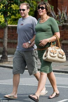Kate Silverton.  I normally don't like the really clingy dresses on pregnant women, but wow, she can really pull this off IMO.