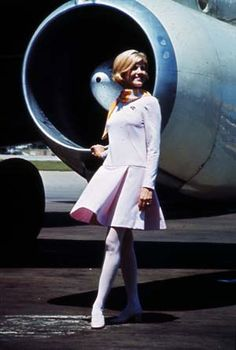 Braniff Stewardess  1960's. Back in the day when you couldn't sit in the jet intake.