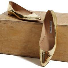 A commuter's dream shoe! Manolo Blahnik gold patent leather flats