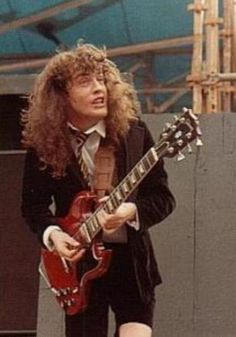 Angus Young :   With a whole lot of hair